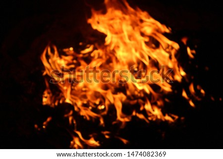 The flames of flaming flames swept through various shapes like hot, energy on a black background. #1474082369