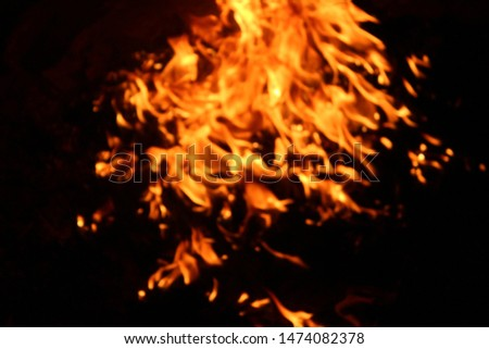 The flames of flaming flames swept through various shapes like hot, energy on a black background. #1474082378