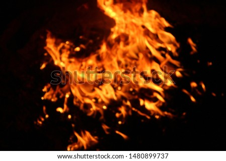The flames of flaming flames swept through various shapes like hot, energy on a black background. #1480899737