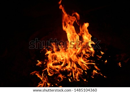The flames of flaming flames swept through various shapes like hot, energy on a black background. #1485104360