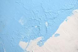 The flesh is white and blue. Wall background with plaster and stain Screensavers or postcards for the holidays.