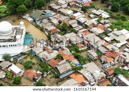 The flooded street in a poor residential district in the heart of Jakarta city in Indonesia capital city