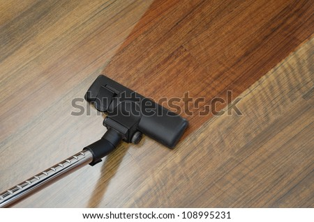 the floor clean with a vacuum cleaner