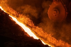 The flow of molten hot metal, molten steel flows along the guide chute. Blast furnace