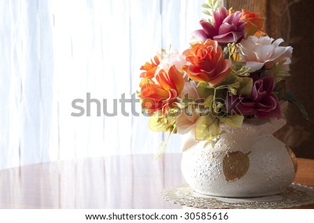 the flower at the window in natural lighting - stock photo