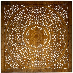 The flowery wood carvings on white background made by Asian craftsmen are subtle and beautiful.