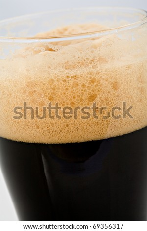 The foam head on stout beer