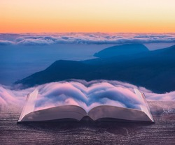 The foggy Crimea mountains on the pages of an open magical book. Majestic landscape. Nature and education concept.