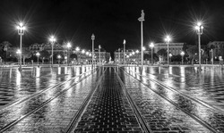 The Fontaine du Soleil on Place Massena in the nights, Nice, French Riviera, France. Black - white photos, old style.