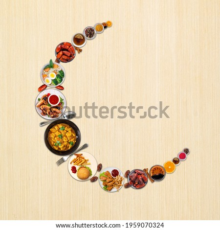 The food is arranged in such a way that it looks like a half moon. It's represent muslim festival Eid.