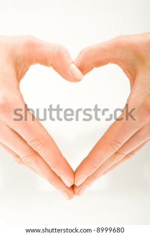 The form of heart shaped by female hands on a white background