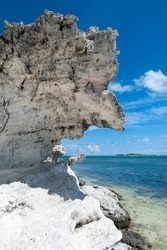 The formation of eroded hanging rock over the shore of Grand Turk island (Turks and Caicos Islands).