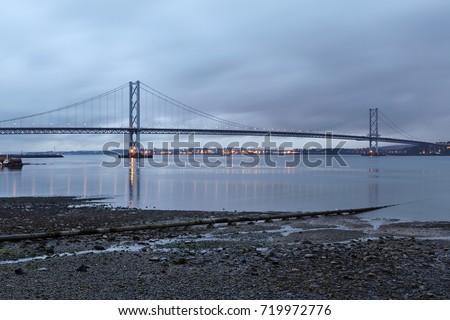The 'Forth Road bridge' suspension bridge spanning the Firth of Forth illuminated at dusk #719972776
