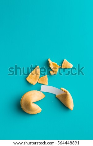 The fortune cookies on blue background. Top view.