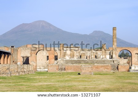 The Forum and Temple of Jupiter of Pompeii with Mount Vesuvius in the background.  Covered by eruption in 79 AD.