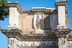 The Forum of Nerva at the portico of the Temple of Minerva with a relief sculpture of the goddess behind. Rome, Italy