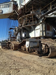 The foundation of a huge rotary excavator working on the development of a sand pit.