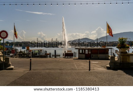 The fountain in Geneva, beats up against the background of the city and boats.
