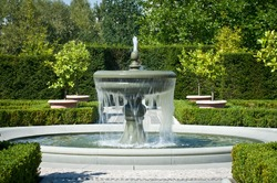 The fountain in the garden in the style of renaissance.