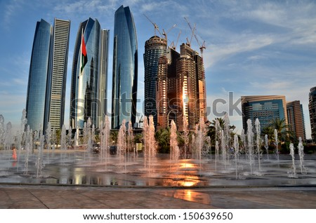 The fountain on the background of skyscrapers in Abu Dhabi United Arab Emirates