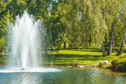 The fountain on the lake in the park.