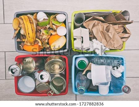 The four different container for sorting garbage. For plastic, paper, metal and organic waste Stock foto ©