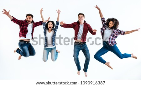 The four happy people jumping on the white background #1090916387