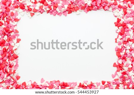 the frame is made up of many small hearts on a white background ...