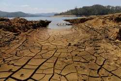 The frame of a car is revealed by the receding water line at the bottom of Cantareira dam during a severe drought in Nazare Paulista, Sao Paulo state, Brazil.