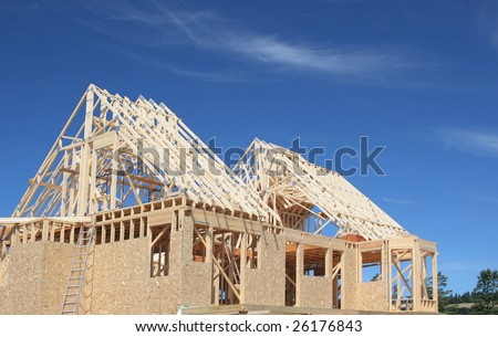 The frame of a new house under construction. - stock photo