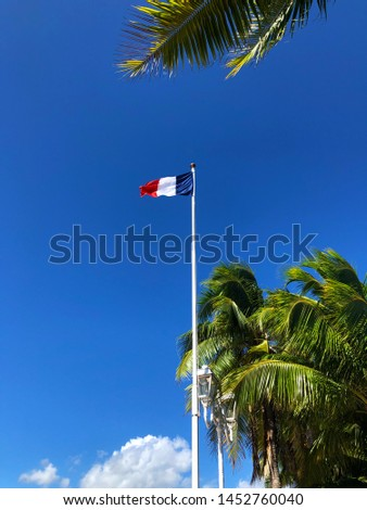 The French Tricolor flag flying in Pape'ete, Tahiti, the city capital of french Polynesia which is a French collectivity or country. The citizens are citizens of France and carry French passports.