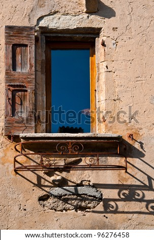 The French Window on the Facade of  Old House