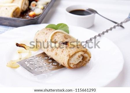 The fried pancakes with meat and baked vegetable