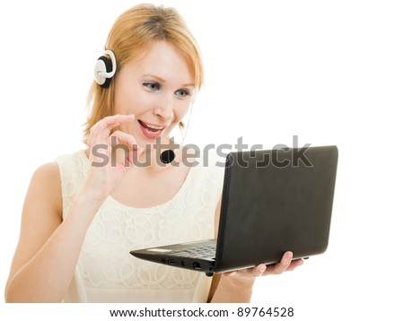 The friendly woman operator displays okay with a laptop and headphones.