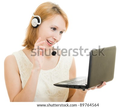 The friendly woman operator with a laptop and headphones.
