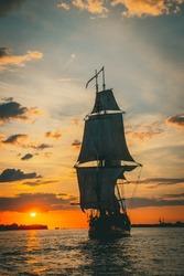 The Frigate Shtandar in calm weather sailing sunset time Riga Latvia