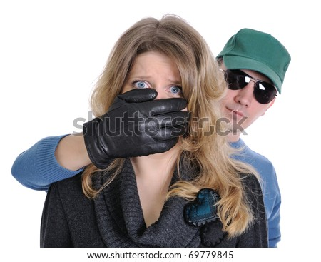 The frightened woman. Man hand covers her mouth. She is shocked and horrified.