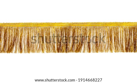 The fringe is golden with a long thin pile. Isolated on white background. Decor, design, decoration, texture. Stockfoto ©