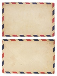 The front and back of an aging airmail envelope with red and blue striped border. Isolated on white with clipping path.