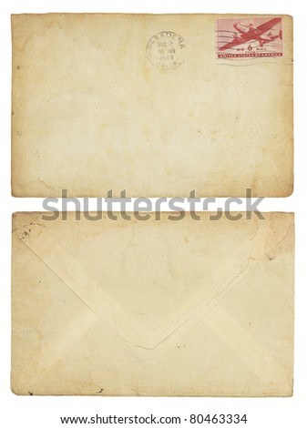 The front and back of an aging, 1944 United States airmail envelope with canceled postage stamp. Isolated on white with clipping path. - stock photo
