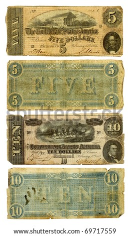 The front and back of two dirty, very worn five and ten dollar bills from the United States. Printed by the Confederate states in 1864 during the Civil War. Isolated on white. Clipping path included.