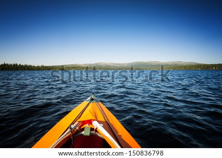 The front end of a Kayak traveling on the system of lakes in northern Russia