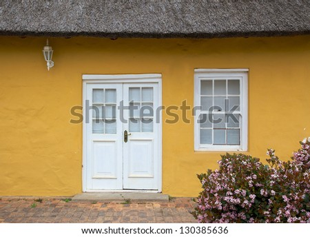 The front entrance to a traditional thatched cottage in the town of Greyton, in the Overberg region of the Western Cape, South Africa.