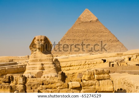The front face and body of the Sphinx and the biggest Great Pyramid of Khafre appear side by side in the desert of Giza, Cairo, Egypt. Horizontal Copy Space