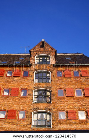 The front of a old historic storehouse close to Nyhavn harbor