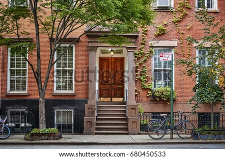The front of an ornate brownstone building in an iconic neighborhood of Brooklyn in New York City #680450533