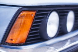 The front part headlight of old blue car.