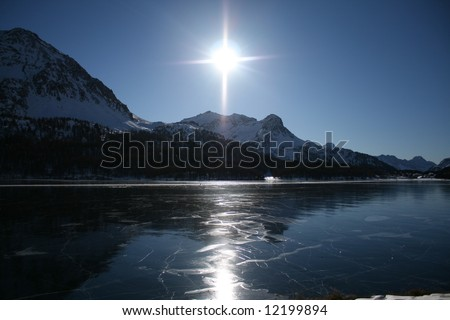 The frozen lake of st moritz in the swiss alps - stock photo