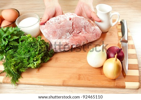 The frozen meat on a kitchen table.