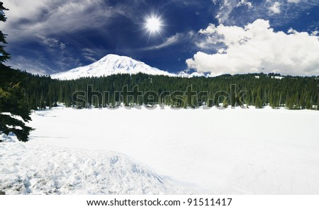 Stock Photo The Frozen mirror Lake and the mount Rainier